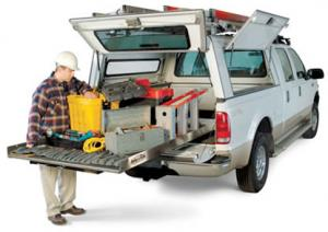 Leading irrigation repair equipment onto the pickup truck